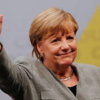 VIDEO: Afghan refugee shouting 'Allahu Akbar' charges German Chancellor Angela Merkel