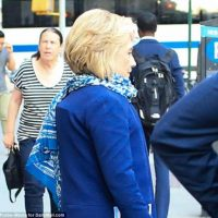 Crooked Hillary Wears $1,100 Hermes Scarf to Hide Bulging Back Brace