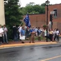 Protesters Outside Red Hen Restaurant Hold Signs That Say 'Trump Is Love' (VIDEO)