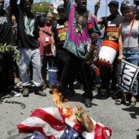 "Maxine Waters Supporters Burn American Flag During Protest – Chant ""Black Power"" (VIDEO)"