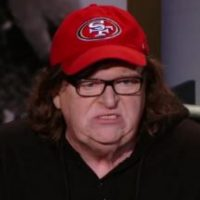Michael Moore belly-flopping at the box office
