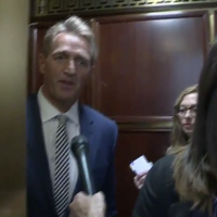 Woman Who Confronted Flake In Elevator Runs Soros-Funded Organization