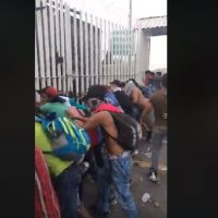 WATCH: Chaos as 'Migrants' Destroy Gate at Mexico's Southern Border