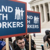 Unions Defy Supreme Court on Mandatory Dues, Suit Says