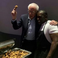 PHOTOS: Bernie Sanders holds up fried chicken leg for pic with black man in SC