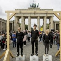 German Climate Protestors Stage Melting Ice Hanging Stunt