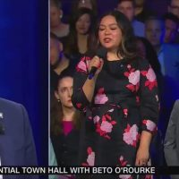 Beto stands silently as 'extraordinary black trans woman' protester crashes time during CNN Equality Town Hall