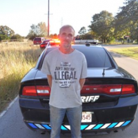 Man wearing 'Ain't Nothing Illegal 'Til You Get Caught!' shirt — caught stealing ATV