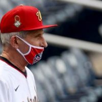 'WHAT A PHONY': Fauci Blasted For Taking Off Mask At Ballpark After Terrible First Pitch